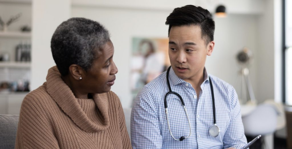 Medical Doctor Talking to SSDI Applicant